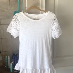 White t-shirt with lace shirt sleeves.